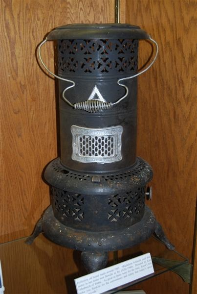 Perfection Oil Heater, ca. 1913 by South Dakota State Historical Society, via Flickr