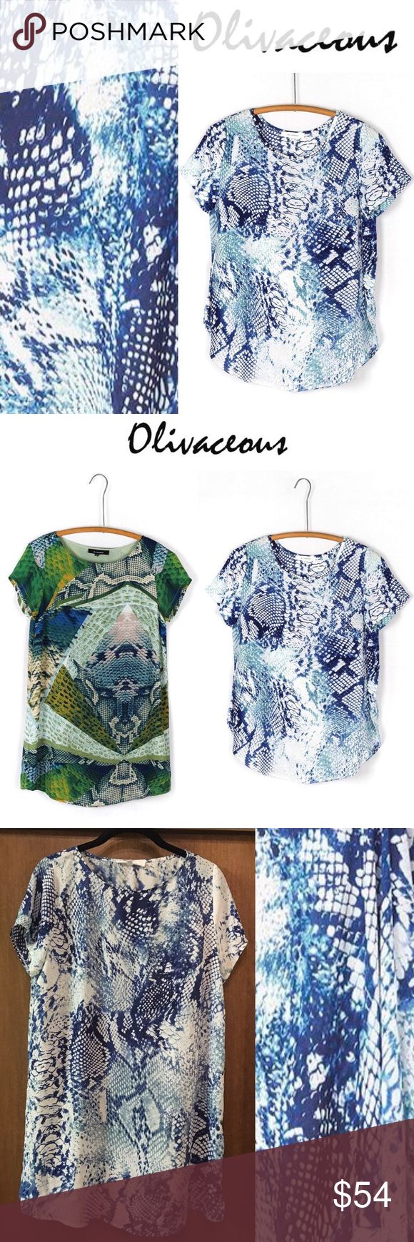 🔥 90% OFF NWOT Olivaceous Blue Snakeskin Tunic Olivacious blue and white short sleeve tunic shift dress. Be effortless but chic in this blue and white tunic dress pair with your favorite boot to complete your look. * SIZE LARGE * BRAND NEW WITHOUT TAGS - NEVER WORN * SHOWN IN STOCK PHOTOS ARE THE SAME PRINT (but in a top) and THE SAME STYLE (but in a slightly different print)  * 100% Polyester Olivaceous Dresses Mini
