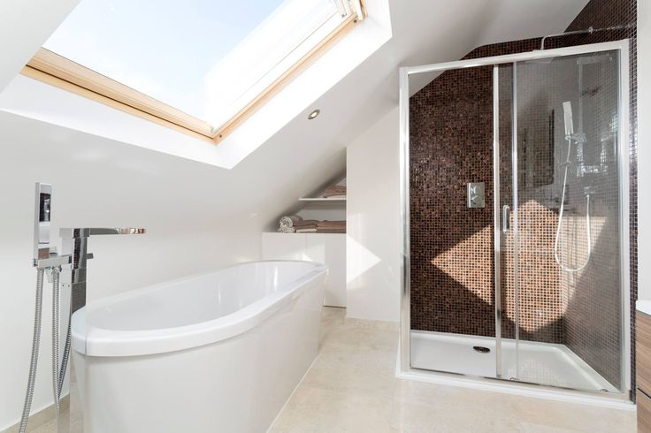 This bathroom has lots of natural light and the feeling of space thanks to the clever use of a large roof window. Image via @simplyloft