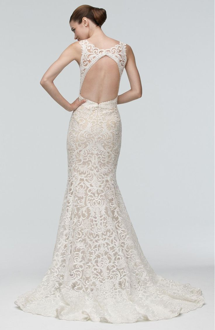 Exquisitely embroidered lace lends glamorous, vintage-inspired elegance to an entrancing gown