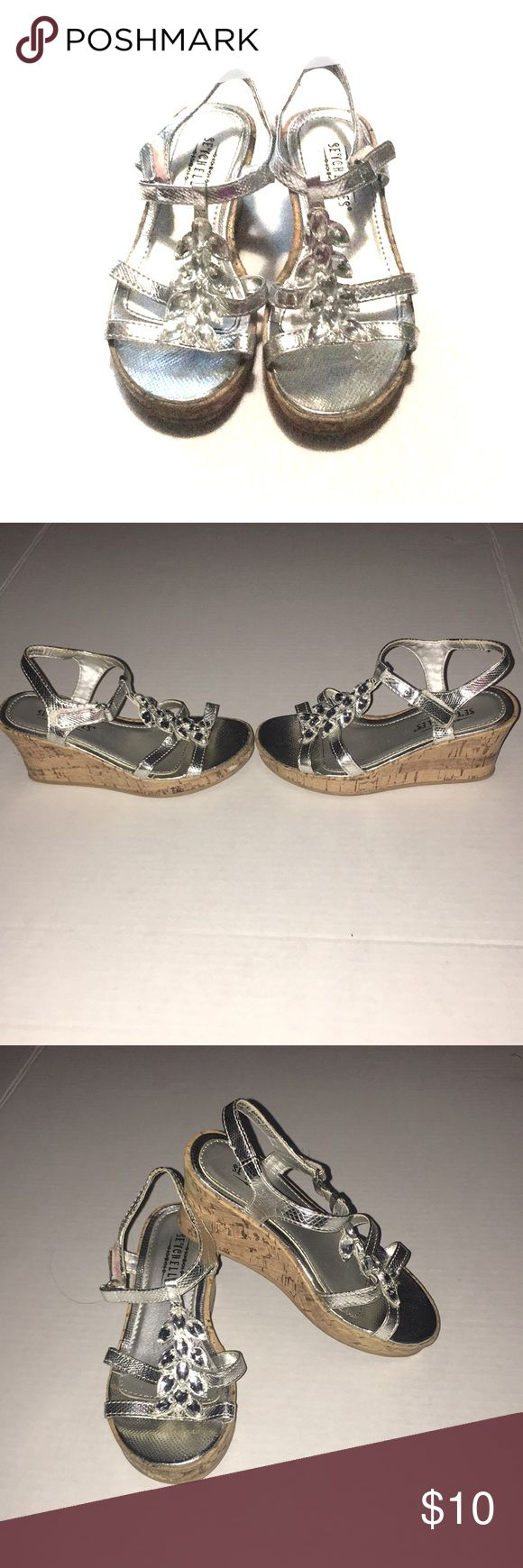 Silver Wedge Shoes Super chic silver wedges for girls size 11. Designed with jewels to compliment the shoe and give it more bling. Rarely worn, in good condition 😊 sevchelles Shoes Dress Shoes