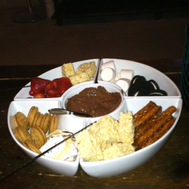 Chocolate Fondu ideas....strawberries, bananas, cake chunks, rice crispy bars, pineapple, mini Oreos, grapes, pretzel sticks, apples, graham crackers...