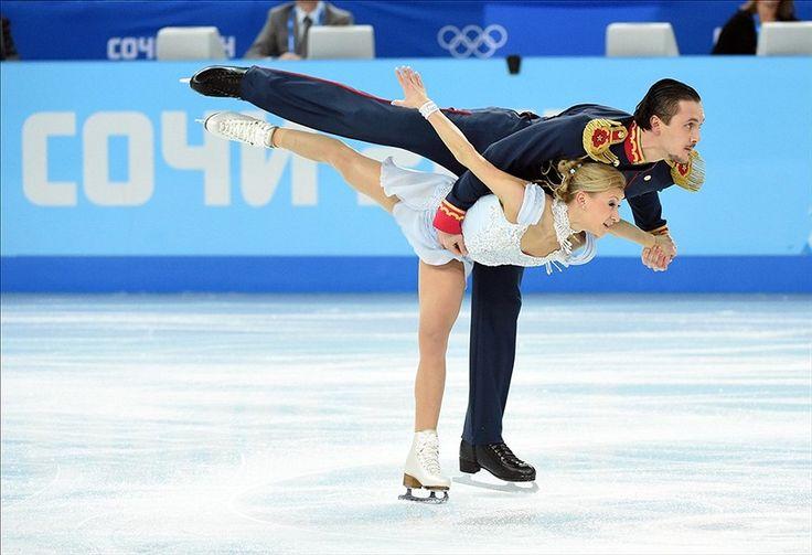 Feb 6, 2014; Sochi, RUSSIA; Tatiana Volosozhar and Maxim Trankov (RUS) perform in the figure skating team pairs short program during the Sochi 2014 Olympic Winter Games at Iceberg Skating Palace. Mandatory Credit: Robert Deutsch-USA TODAY Sports