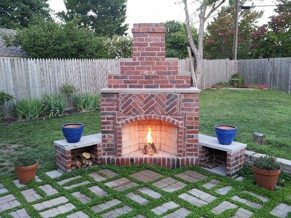 brick faced small outddor patio corner fireplace jpg