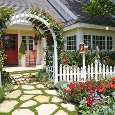 knockout roses against white picket fence -and the stone walkway is darling.