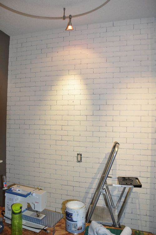Faux Brick Wall Tutorial - this looks like a fun project that can really change the style of a room dramatically