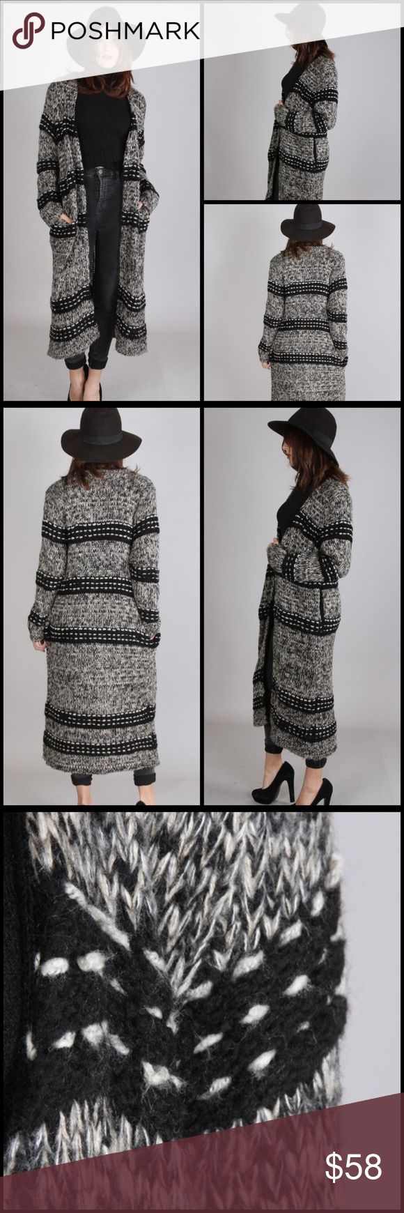 Black And White Maxi Sweater Coat Open front black and white knit pattern long sweater cardigan-coat. Features long sleeves and pockets. 75% acrylic 25% wool. Sweaters Cardigans