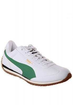 Ideal for any outdoor activity these white pair of Puma sports shoes are designed for a true outdoor person. The green colour on white looks stylish and catches the attention. Make a youthful fashion statement and get going with these shoes. These can be paired with any casual outfit for the right look.
