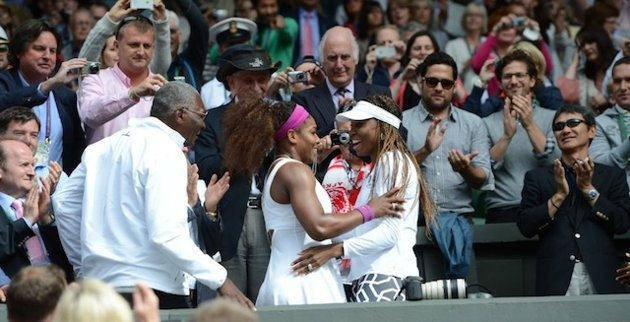 Serena embracing Venus after winning at Wimbledon 2012.
