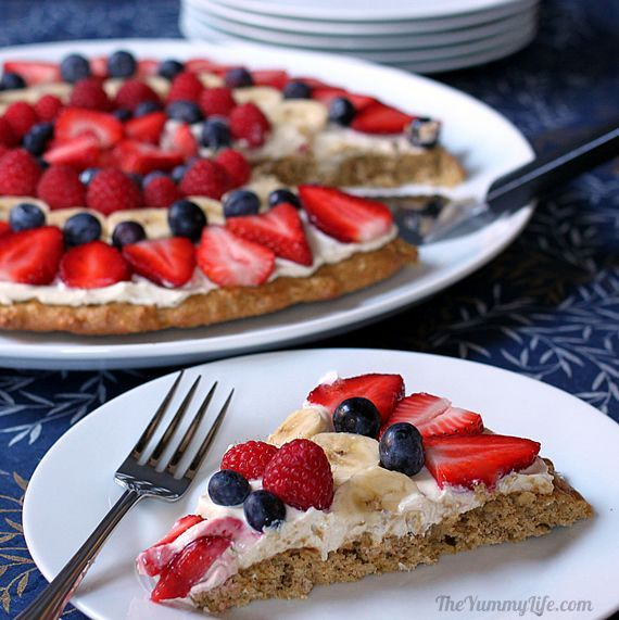 Healthy fruit pizza with oatmeal crust and peanut butter yogurt frosting.