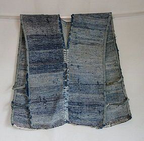 Japanese Vintage Textile Boro Sakiori Sodenashi Indigo. Boro sakiori sodenashi (vest) whose wefts are recycled strips torn from old cotton kimono, futonji and so on. The warps are asa (hemp). The sakiori textiles were mostly made in the regions along the Japan Sea side where the cold weather made it hard to cultivate cotton. It has cloth with hand stitched sashiko in the top of the back. 49cm x 63cm Late 19th to mid 20th century. The natural indigo color faded and has much wear and breaks.