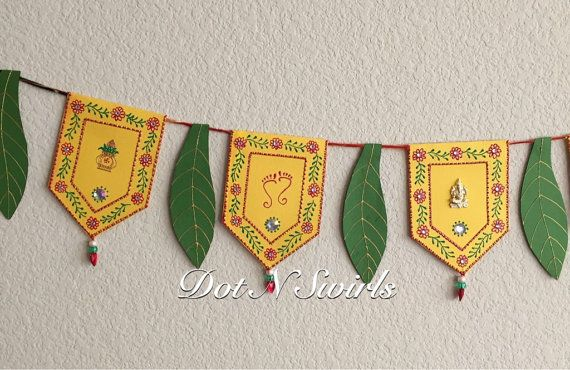 Handmadecard stock toran with mango leafs  decorated with