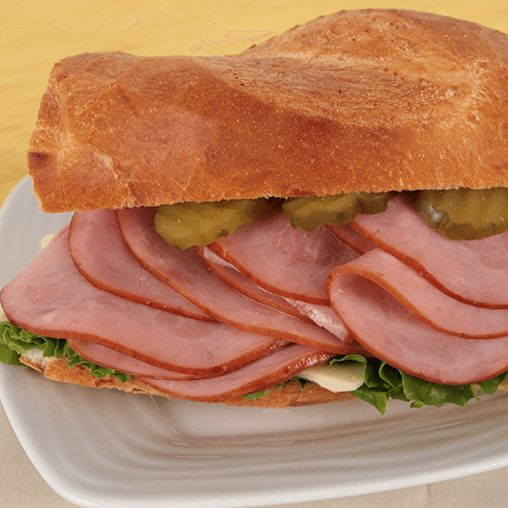 Cuban-Style Ham Sandwich - With a few pickles, Dijon mustard, a French roll and Hillshire Farm® Ultra Thin Lower Sodium Smoked Ham, it's easy to give lunch a little Latin flavor.