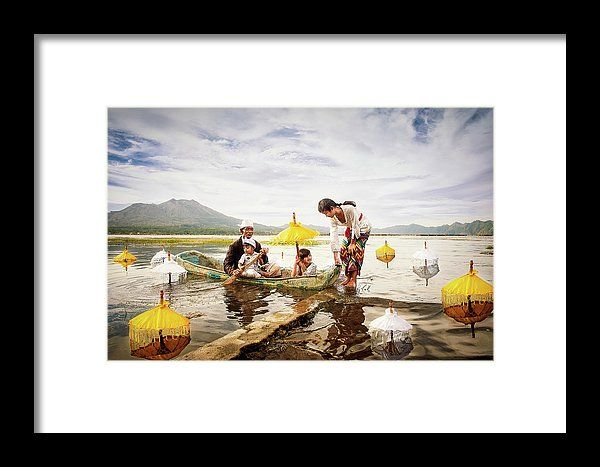 Back Home Again by Elena Riim. Traditional balinese fisherman with his children siting in the boat. Lake Batur,on background mount Agung. Indonesia.  Available as framed prints, acrylic and metal prints and canvas any suitable sizes to enrich the interior with vivid exquisite colors. #ElenaRiimFineArtPhotography, #Fisherman, #BackHomeAgain, #Asia, #LakeBatur, #MountAgung, #HomeDecor, #WallArt, #AcrylicPrints, #MetalPrints, #GiftIdeas, #PrintsForSale, #FineArtPrint