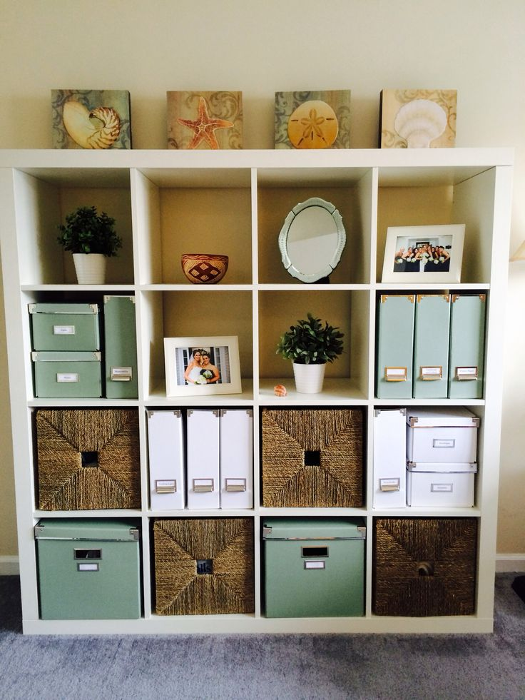 Neat Home Office storage | White Ikea Expedit Bookcase | White and Green Ikea Kassett Boxes and Magazine Files
