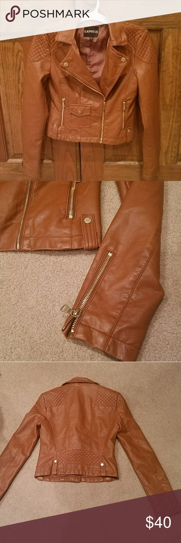 Express brown faux leather jacket like new XS Express ladies faux brown leather jacket in new condition comes with no tags (flawless) zippers on sleeves, and other hardware on the jacket is Gold tone color. Express Jackets & Coats