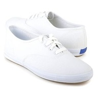 a pair of white Keds with double socks!