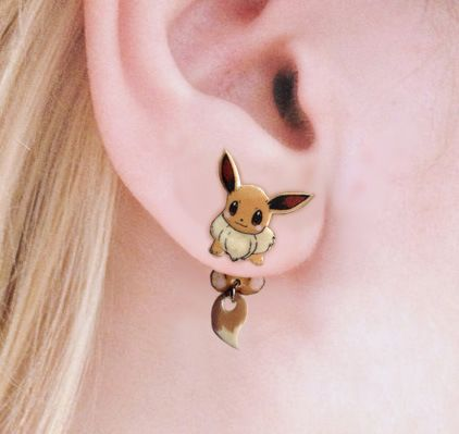Create the illusion of Eevee clinging to your ear with these Pokemon dangling earrings!