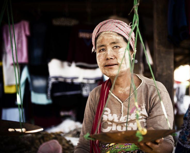 """This lady sells dry seafood (such as fish, prawns, etc) in the market, it's more like a snack in Myanmar.  She is also wearing """"Thanaka"""" on her face, which is a sort of make up that people use for cooling the skin and sun protection.  Market Seller – #Kalaw, #Myanmar"""