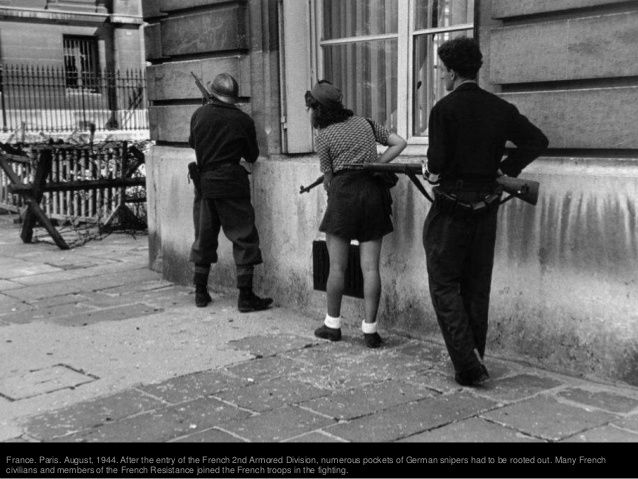 France. Paris. August 25th, 1944. Members of the French resistance standingin a doorway during the Liberation of the city.