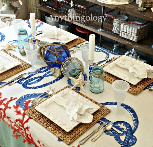 Nautical Table Setting With Tablecloth And Glass Floats