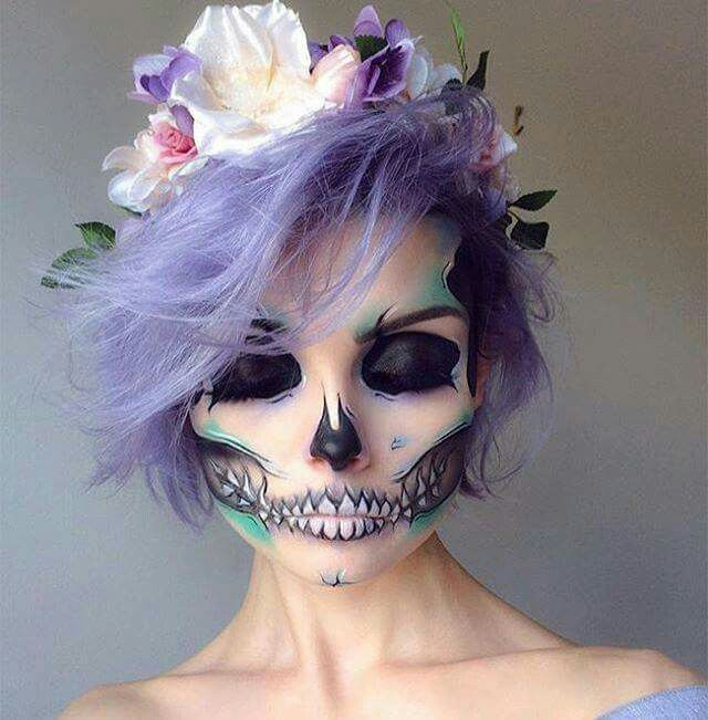 Pastel goth inspired skeleton beauty makeup fir Halloween or horror event / party | love the floral head piece crown and purple hair, divine