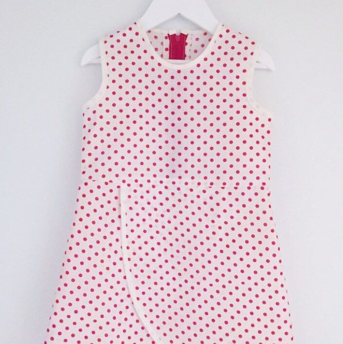 Polkadots- gotta love 'em! This is a size 3 years, click it home now before someone else does!