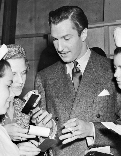 talentspast: Vincent Price signs autographs for a group of female admirers on the set of Service de Luxe, c. 1938