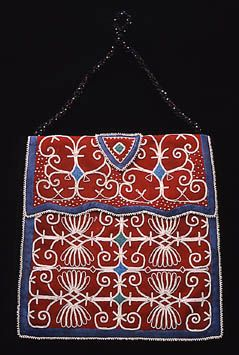 """Title Bag Date 1840-1850 Physical Dimensions Ht: 11 1/2"""" W: 11"""" Notes: ht: 20"""" including fringe Identifier T0779 Description Micmac Bag Inward curling lines, often referred to as double curve motifs, are prominent design elements on these bags. Similar beadwork is found on formal clothing such as chief's coats, hoods, caps, moccasins, and sashes. Micmac beadworkers always selected the finest red or blue wool because it provided a rich contrast to their intricate beadwork."""