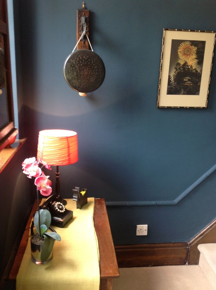 Hague Blue on walls, retro phone, coral and tangerine accents - hallway finished in our Edwardian house.