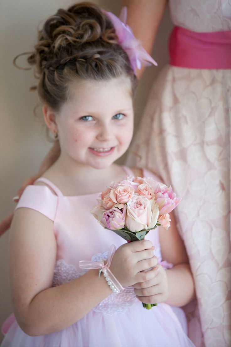 Braided part and Barrel curls create a young fun look to help make your flower girl feel like a princess