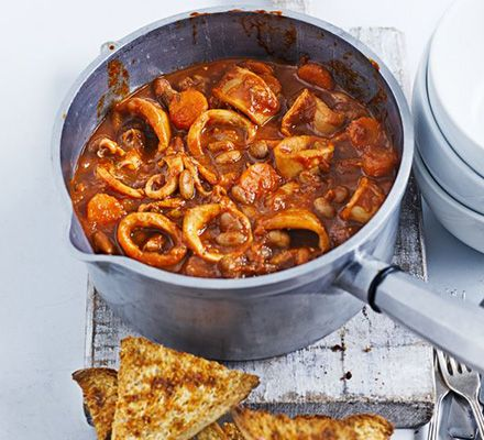 Slow cook squid with paprika, tomato and pinto beans for a robust one-pot meal filled with tender shellfish. Serve with garlic bread on the side