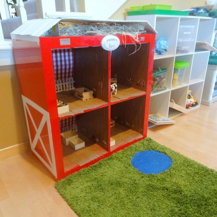 I hacked an Ikea Expedit red lacquer shelf into a red barn for my daughter this holiday season.   http://terroirandtatertots.wordpress.com