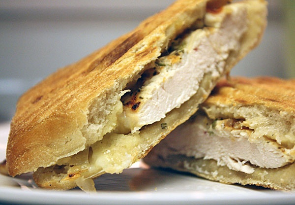 : Grilled herb chicken panini with apple butter, caramelized onions ...