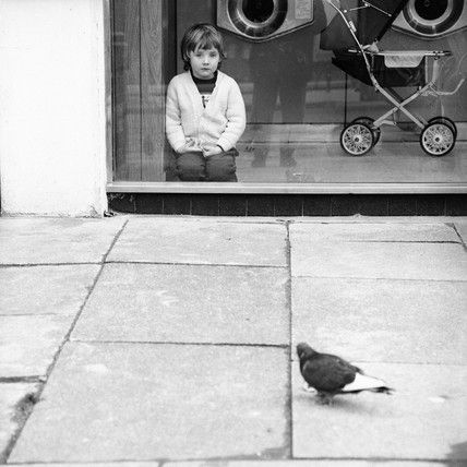 Boy watching a pigeon in Boreham Wood c.1965, Henry Grant