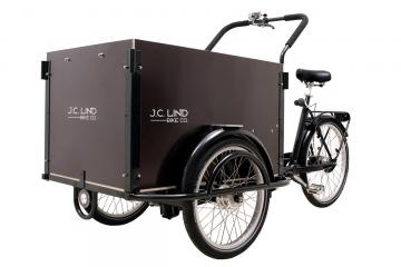 J.C. Lind Triple Lindy cargo bike. Cargo cabin has fold down bench with two seat harnesses.