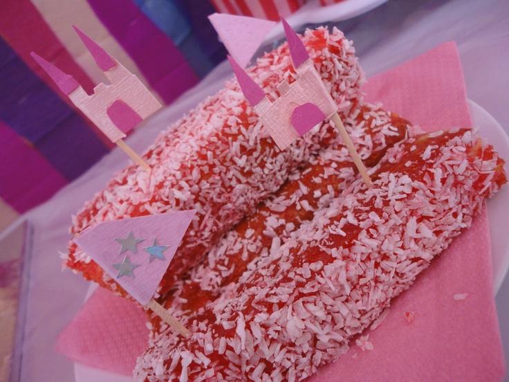 Little pink finger lamingtons are easy to make....cut up sponges into finger sizes, dip into raspberry jelly (with a little water) then roll in coconut. Add some little flags to decorate and there you have it.