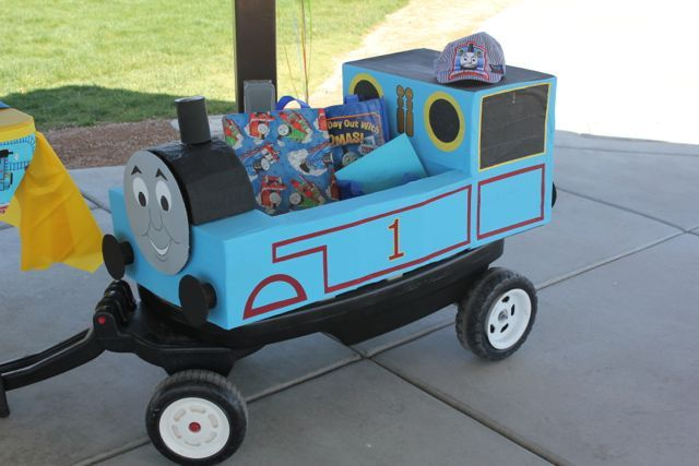 Thomas the Train costume: diaper boxes, blue, yellow, and gray paint (?), red duct tape, sharpie marker, black construction paper (?)...play around with it. Silas could wear the conductor's hat.