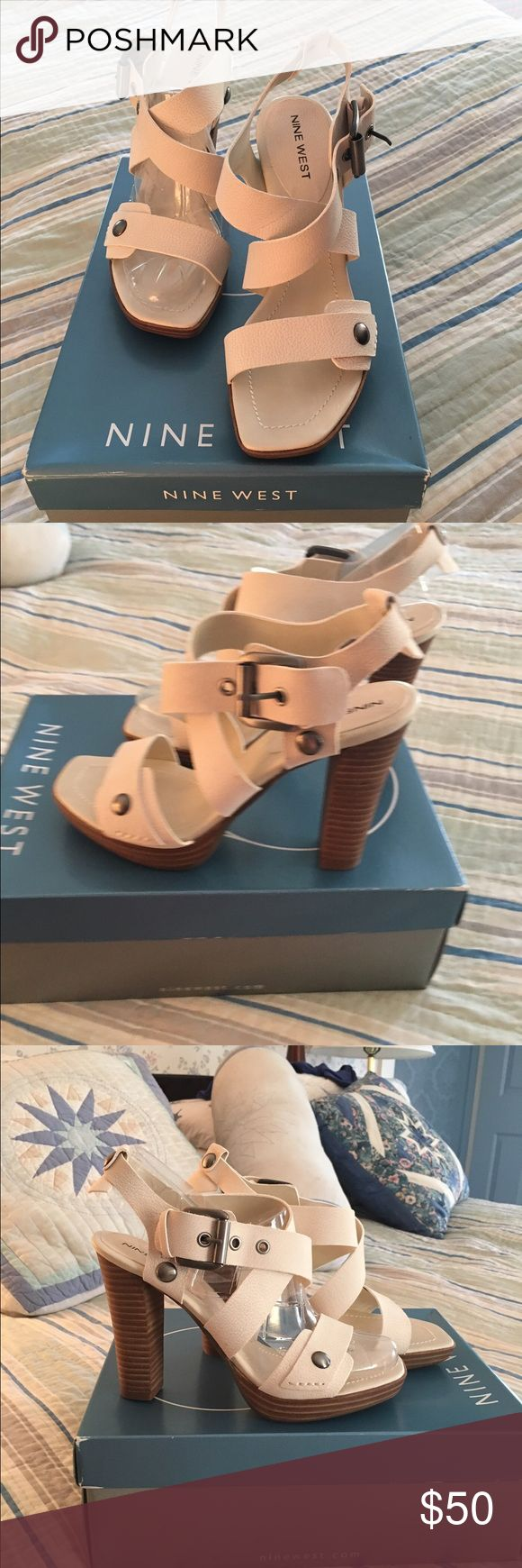 "Nine West ""Elirissa"" Open Toe Platform Heels Ivory sandals with leather uppers, man made soles and decorative silver hardware. The insoles are nicely cushioned and the height is very comfortable due to the broadness of the heel. Perfect condition, never worn. (Stickers still on).  4.5"" stacked heel. .75"" platform.  Original box. Perfect for Spring 🌺🌸🌼 Nine West Shoes Platforms"