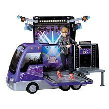 Justin Bieber Tour Bus and Concert Stage by The Bridge Direct. $61.08. Recommended Age: 6 years and up. Product Description Justin Bieber always gets to the show in style with the new Rockin' Tour Bus & Concert Stage playset! A place for your JB dolls to perform for all your friends, the Rockin' Tour Bus features a pop-up concert venue with real stage lights and a spinning stage! MP3 connection and speaker let you pick the playlist for Justin's big performance from your very ...