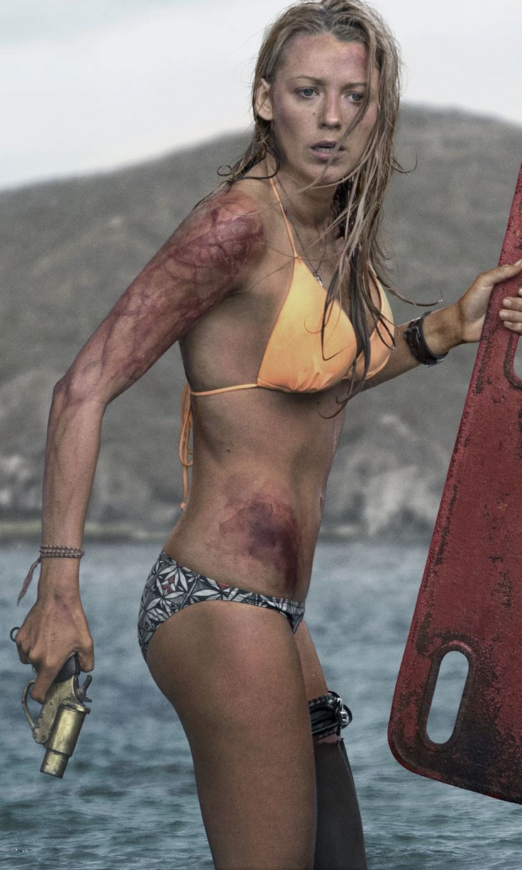 Blake Lively somehow makes fending off a giant shark look glamorous in this photo from her upcoming thriller, The Shallows.