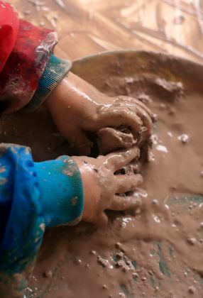 Mud dough 1/2 cup cold water; 1 Tbls.cooking oil; 2 Tbls. brown tempera paint; 1/2 cup salt; 1 Tbls. cornstarch; 1 1/2 cup of white flour. Mix together in bowl. Divide and place on table to knead.