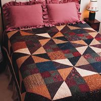 Country Comfort is a free pattern!  The arrangement of easy-to-make triangle-squares and four patches gives this bed-size quilt interest. Select squares in country colors as designer Bev Getschel did, or choose your own color scheme.
