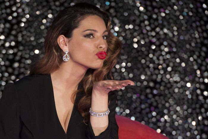 """Born in the small historic town of Rochester, England, Kelly Brook began her illustrious career in modeling at the tender age of 16. Brook is very active on Instagram; her latest buzz coming from a topless """"selfie"""" she took with boyfriend Jeremy Parisi, in which she rocked a huge diamond ring on her engagement finger."""