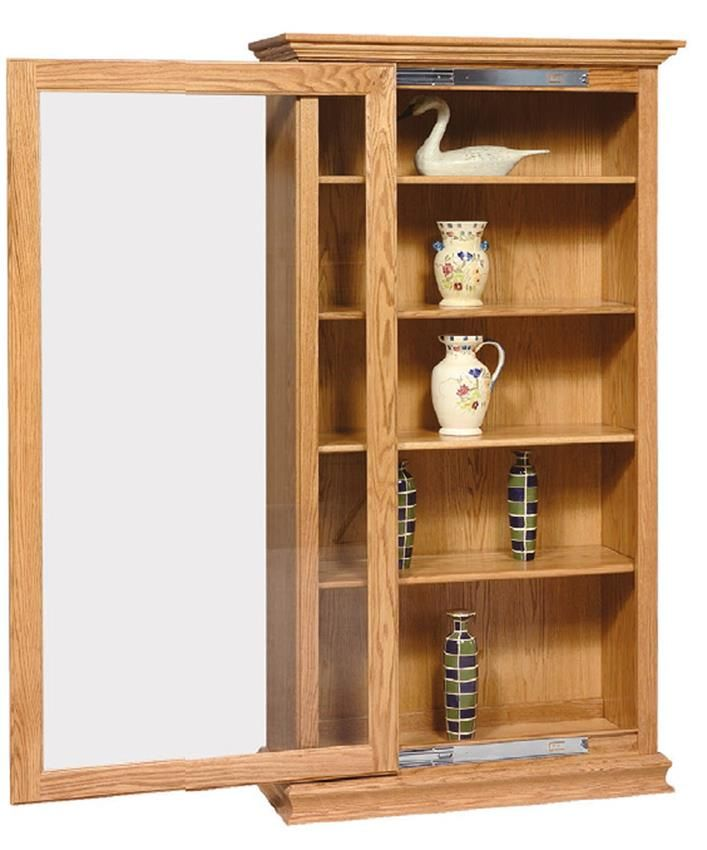 Beauty and funciton are combined with our Amish Furniture Solid Wood Sliding Door Large Bookcase. This bookcase offers maximum storage as well as keeping everything protected behind the sliding glass doors. Amish craftsmanship at its best with this solid wood bookcase! Your books and collectables deserve to be displayed in a piece of furniture made by a woodworker who has built his reputation on curio and display cabinets.
