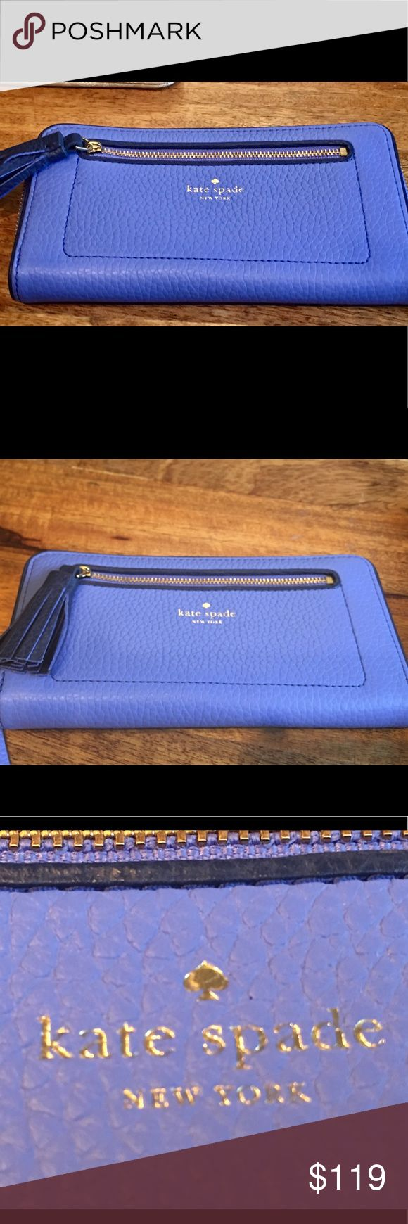 Kate Spade Chester Street Neda Wallet Skate Spade  Chester Street Neda wallet. Gorgeous soft pebbled leather in a purplish blue color. Roomy and factional for your everyday needs.  About this item Features:  Classic soft pebbled leather with gold tone hardware and a tassle zipper pull Zip around style wallet with KS logo embossed on front and open slip pocket on back, extra zip pocket on front Leather and fabric interior with 12 card slots and multiple full length bill compartments, Center…