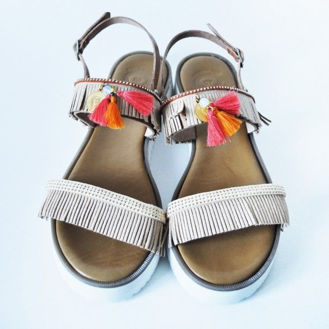 Handmade Greek genine leather sandals with white rubber sole, beige suede fringes and elements in orange color.