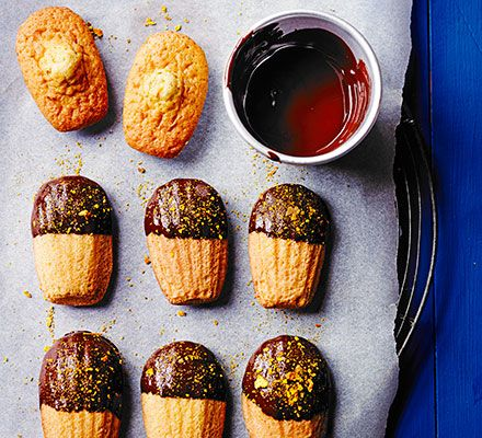 Best enjoyed fresh from the oven, these delicate madeleines dipped in dark chocolate and dusted with blood orange powder make a delectable dessert