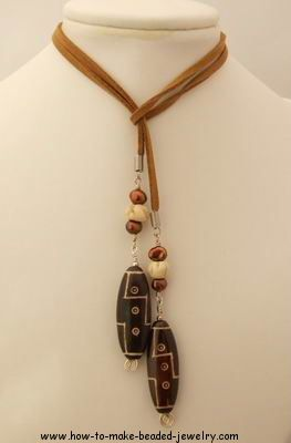 Lariat necklace. (I usually don't care for leather in necklaces, but this is a definite exception.)