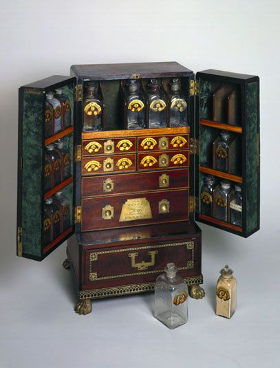 Medicine chest, c 1800.  It features a series of drawers, and bottles stored on shelves which are housed in the doors of the chest. These would have contained various ointments and powders for the relief of everyday ailments.